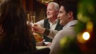 SLO MO  grandpa making a toast at the Christmas table video