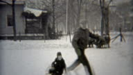 1938: Grandpa showing off ice skating skills on local makeshift rink. video