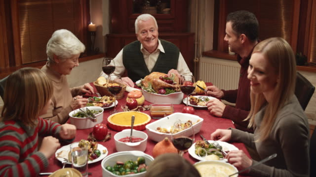 Grandpa telling a story at Thanksgiving dinner video