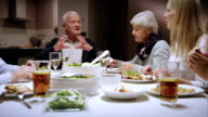 Grandpa telling a story at the dinner table video