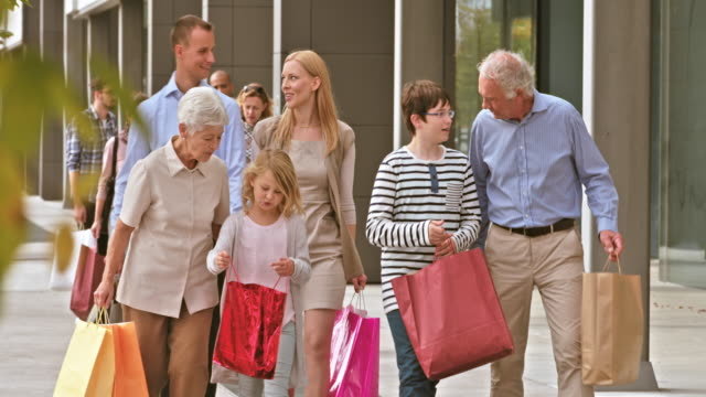DS grandparent and grandkids with shopping bags video