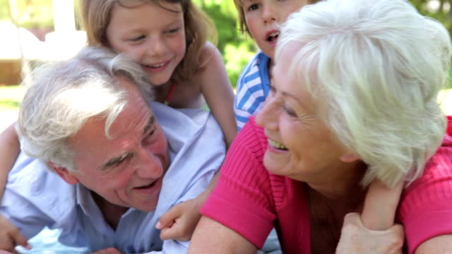Grandparents And Grandchilden Having Fun In Park Together video
