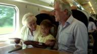 Grandparents And Grandchildren Relaxing On Train Journey video