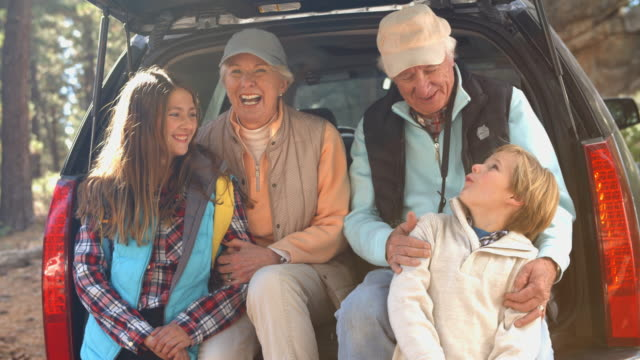 Grandparents and grandkids at the back of car before hiking video