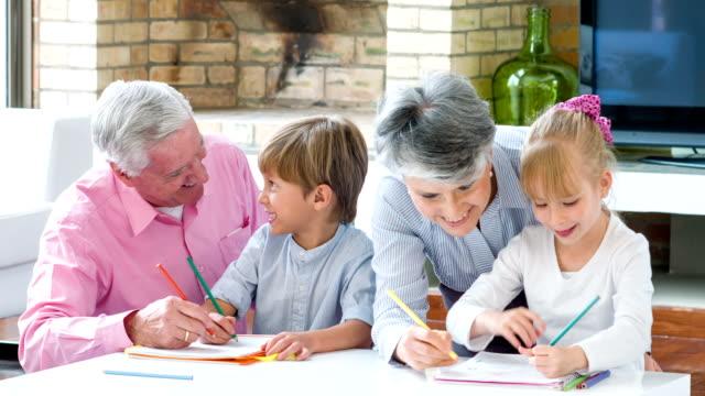 Grandparents babysitting grandchildren at home video