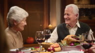 Grandparents having a lovely talk at the Thanksgiving table video