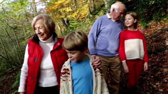 Grandparents Walking In The Woodlands With Their Grandchildren video