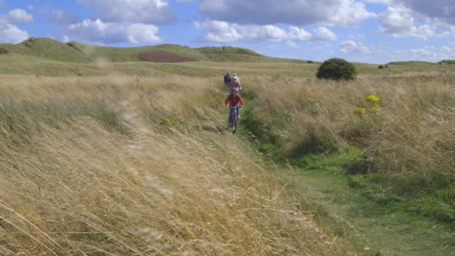 Grandparents With Children Cycling Through Countryside video