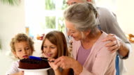 Grands parents and children making chocolate sauce video