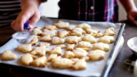 Grandson Helping Grandmother To Bake coockies In Kitchen video