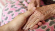 Grandson man holding hand of very old senior woman grandmother video