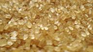 Granulated brown sugar macro dolly shot video