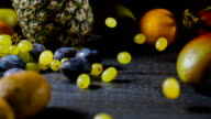 Grapes Falls and Splatters on Table with Fruits video