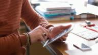 Graphic designer working on a digital tablet video