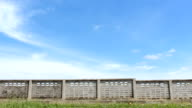 grass brick wall sky time lapse HD video