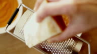 grated Parmesan cheese on squash soup video
