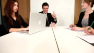 Grateful for positive teamwork in office meeting room video