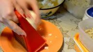 grating cheese video