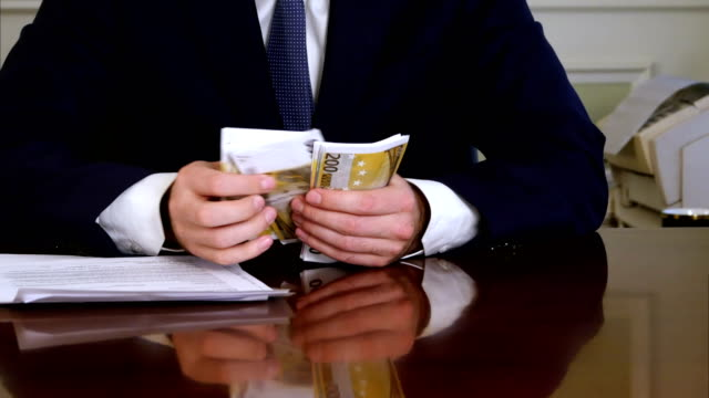 Greedy businessman takes euro packs out of money case video