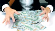 Greedy unrecognizable businessman hands grabbing lot of hundred dollar bills video