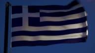 Greek flag fluttering against evening sky video