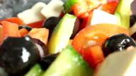 Greek vegetable and cheese salad close up dolly shot, racking focus video