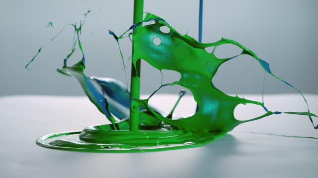 SLO MO green and blue color symphony on white surface video