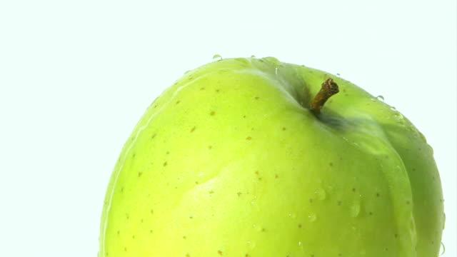 Green apple - water falling down video