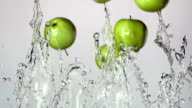 green apple with splashes of water video