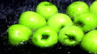 Green apples being washed super slow motion dolly shot video