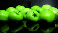 Green apples in water against black background FullHD shot video