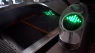 Green arrow traffic signal near escalator video