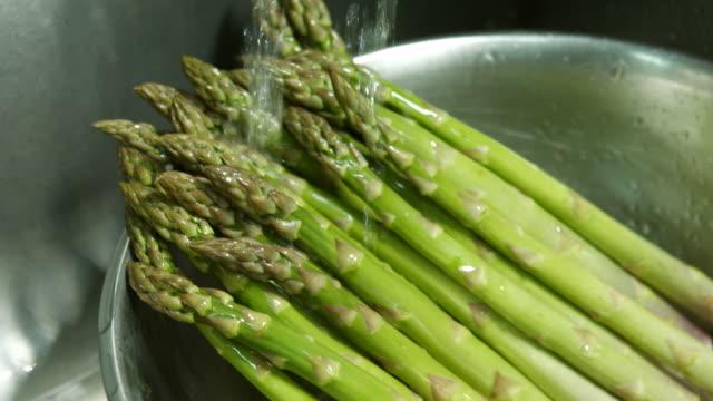 Green asparagus in a basin. video