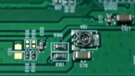 Green board with microcircuits, macro shooting video