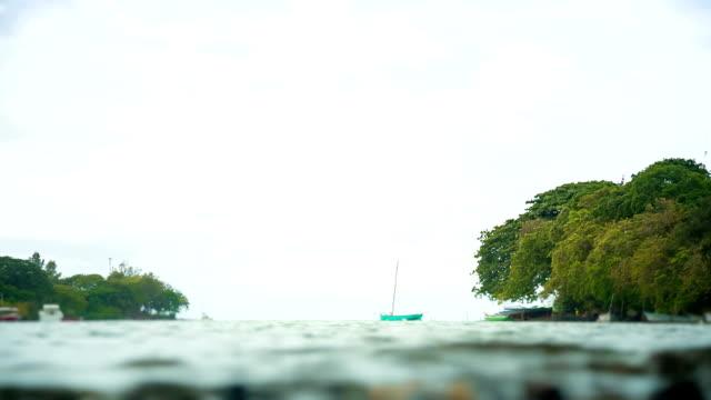 green boat in mauritian river video