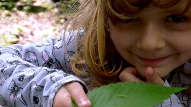 Green Caterpillar on a Leaf Held by a Small Girl video