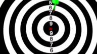 Green dart hitting the bullseye on white background video