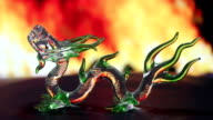 Green glass dragon with fire background video