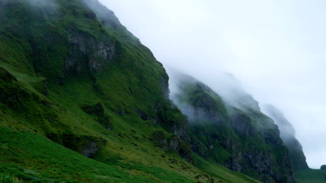 Green mountains in a fog. Iceland. video