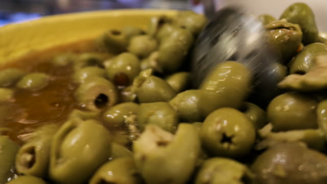 green olives in a bowl in seville spain video