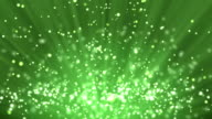 Green particle background and light rays video