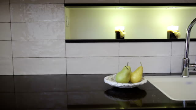 Green pears on the kitchen table video