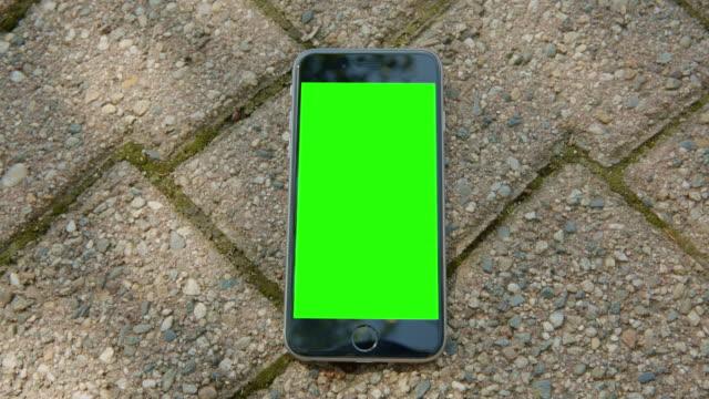 Green screen chromakey mobile smartphone ground brick stone video