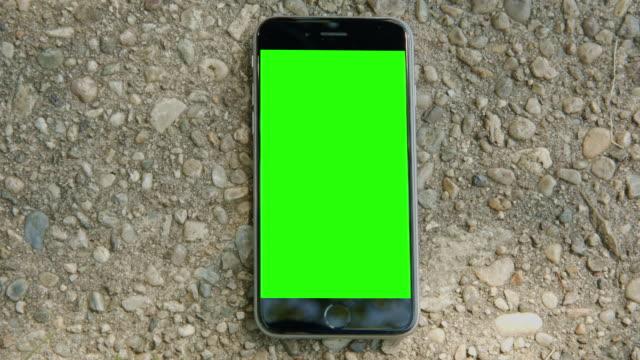 Green screen chromakey smartphone mobile ground sun reflection video