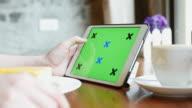 Green screen of Digital tablet in Coffee cafe, 4K(UHD) video