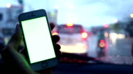 green screen, person using a smart phone in car video