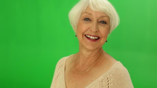 Green screen portrait of senior woman video