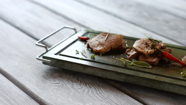 Green tray with cooked meat. video