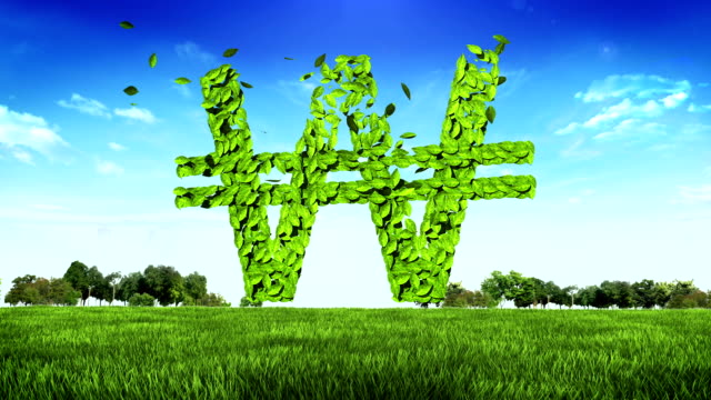 Green Won currency sign, made from leaves on green ground video