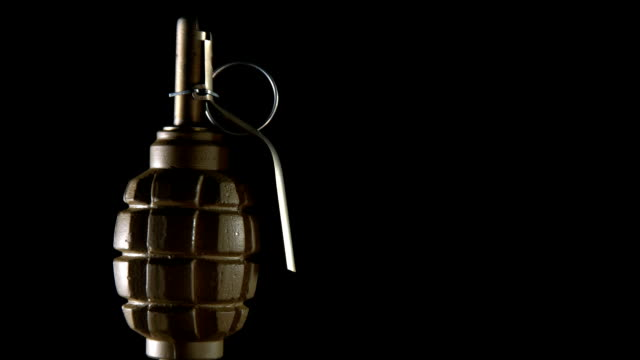 grenade rotates on a black background video